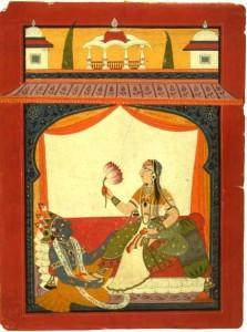Lord Krishna sits at Radha's feet
