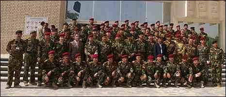 In happier times: New Iraqi army officers at their graduation ceremony at the Joint Staff College at Camp Rustumiya, Baghdad