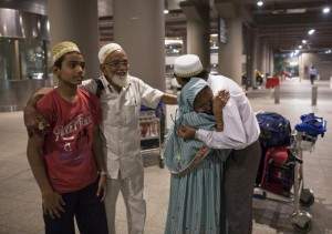 An Indian evacuee from Yemen hugs her son after arriving at the international airport in Mumbai
