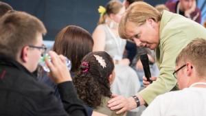 Angela Merkel comforts a crying Palestinian refugee in Rostock
