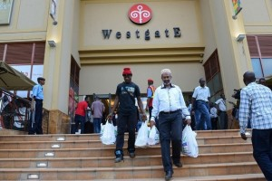 Customers leave the Westgate shopping mall after it reopened on July 18, 2015 in Nairobi, Kenya. Simon Maina / AFP