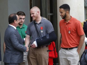 French president Francois Hollande bids farewell to US Airman Spencer Stone as American National Guardsman Alek Skarlatos of Roseburg, second from left, and Anthony Sadler, a senior at Sacramento State University in California, look on, at the Elysee Palace in Paris, France. The three American travelers say they relied on gut instinct and a close bond forged over years of friendship as they took down a heavily armed man on a passenger train. Michel Euler / AP Photo