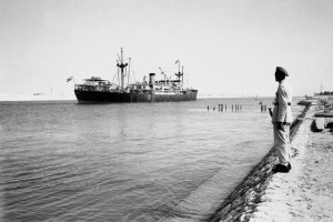 A soldier stands guard as the Argentine cargo ship Mabel Ryan sails through the Suez Canal south to the city of Suez, in 1956. AP Photo