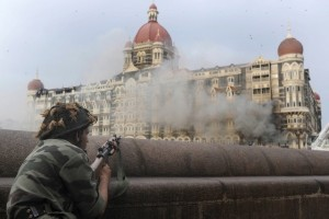An Indian soldier aiming his weapon towards The Taj Mahal Hotel in Mumbai during the siege in November 2008. Pedro Ugarte / AFP Photo