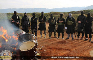 Isil fighters in Libya burn drums