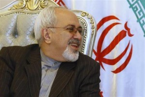 Iran's Foreign Minister Zarif smiles during a meeting with his Iraqi counterpart Hoshyar Zebari at the Baghdad International Airport