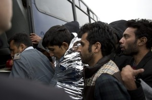 Syrian men get in a bus to Moria camp after 127 refugees and migrants were rescued by the Greek coast guard on March 22. Petros Giannakouris : AP