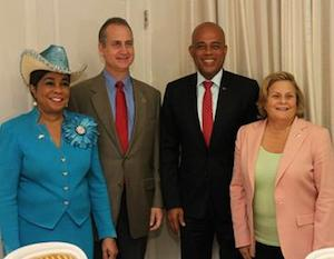 Members of Congress Ileana Ros-Lehtinen (extreme right), Mario Diaz-Balart and Frederica Wilson with Haitian President Michel Joseph Martelly in March 2014