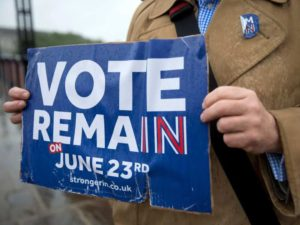 A campaigner holds a placard promoting the official remain case. Justin Tallis / AFP