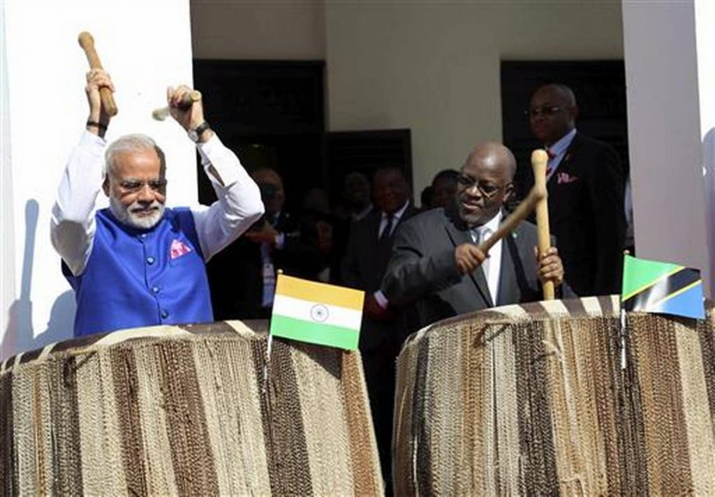 Indian prime minister Narendra Modi, left, and his host Tanzanian president John Pombe Magufuli, right, beat drums at the entrance of State House during an official welcome ceremony for Modi in Dar es Salaam. Khalfan Said / AP Photo