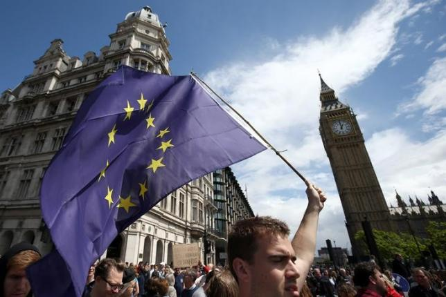 People hold banners during a 'March for Europe' demonstration against Britain's decision to leave the European Union. Neil Hall / Reuters