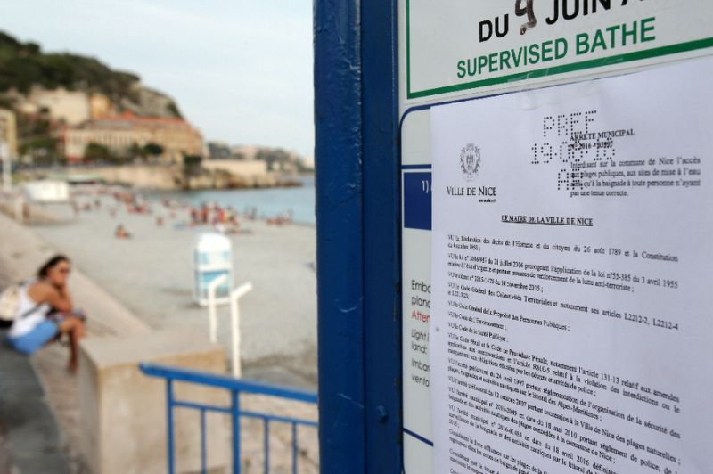 This picture shows the bylaw forbidding women to wear burqinis on the beach in Nice. Jean Christophe Magnenet / AFP