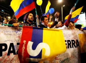 People celebrate in Bogota after the Colombian government and the Revolutionary Armed Forces of Colombia signed a peace deal