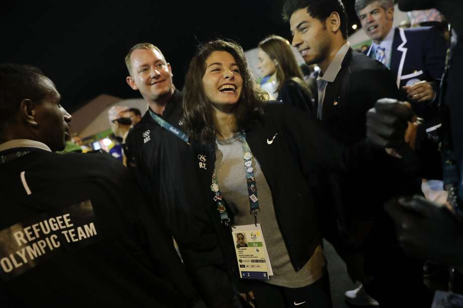 Refugee Olympic Team member Yusra Mardini (C) attends a welcome ceremony held at the Olympic village ahead of the 2016 Summer Olympics in Rio de Janeiro, on August 3rd.