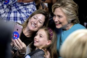 Democratic presidential candidate Hillary Clinton takes a photograph with supporters at a campaign office in Seattle. Andrew Harnik / AP Photo