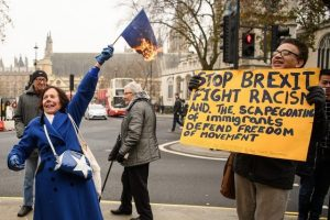 A woman burns an EU flag outside the Supreme Court on the second day of a hearing into whether Parliament's consent is required before the Brexit process can begin, on December 6, in London. Leon Neal / Getty Images