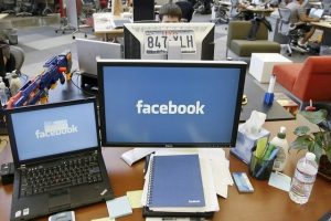 Facebook, a for-profit business that has become the world's most popular social network, is now faced with responsibilities that would be impossible for any one entity – private or public sector – to competently discharge. Tony Avelar / Bloomberg