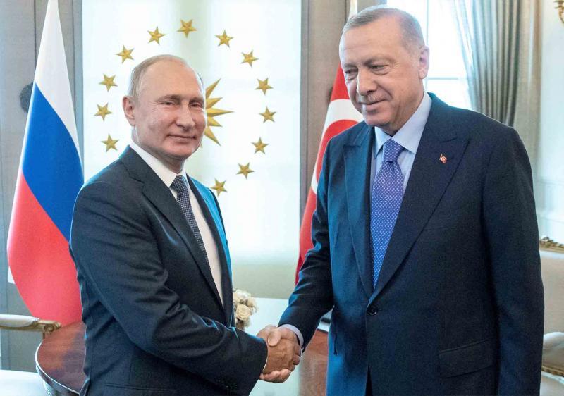 Russian President Vladimir Putin and Turkish President Recep Tayyip Erdogan shake hands during their meeting in Ankara, September 16.