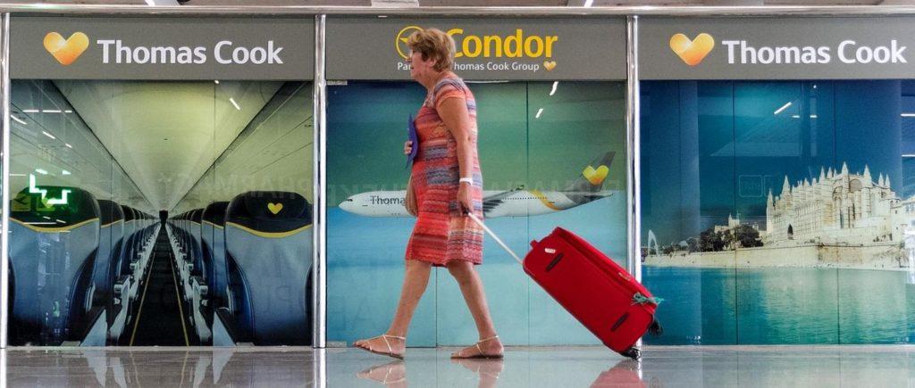 A passenger walks past a closed Thomas Cook office at Palma de Mallorca airport on 23 September 2019.  (AP/Francisco Ubilla)